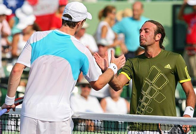 Murray y Massu se saludan