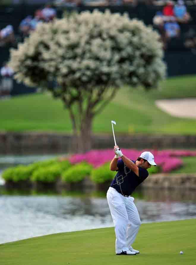 Francesco Molinari, efectuando el swing durante uno de los hoyos del PGA.