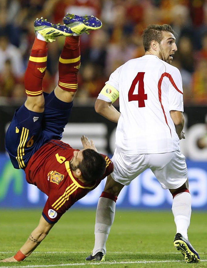 Negredo vies with Georgia's defender Guram Kashia during the match in Albacete.