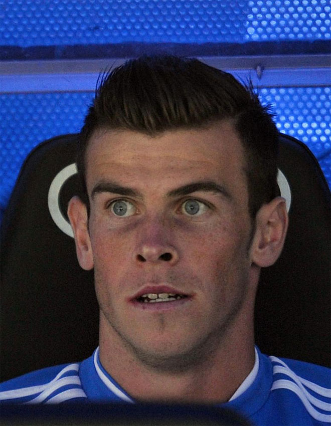 Gareth Bale looks on from the bench before the Spanish league football match Real Madrid vs Malaga.