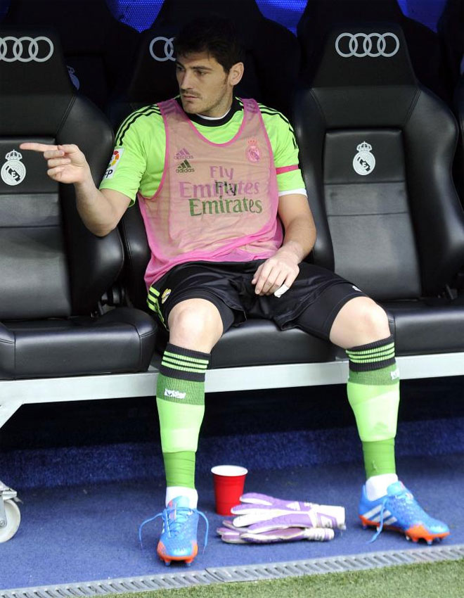Iker Casillas gestures from the bench before the Spanish league football match Real Madrid vs Malaga.