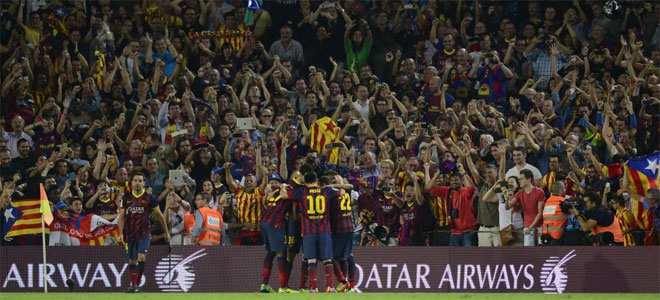 Barcelona players celebrate the second goal during the Spanish league Clasico football match.