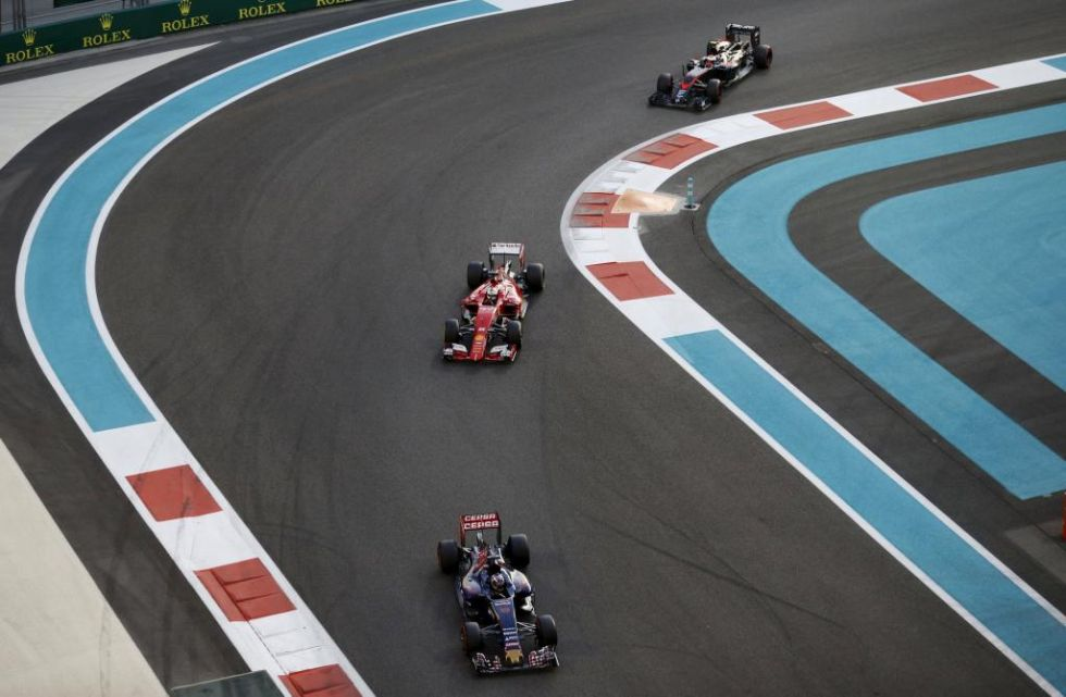 Verstappen, Vettel y Button, durante la carrera.