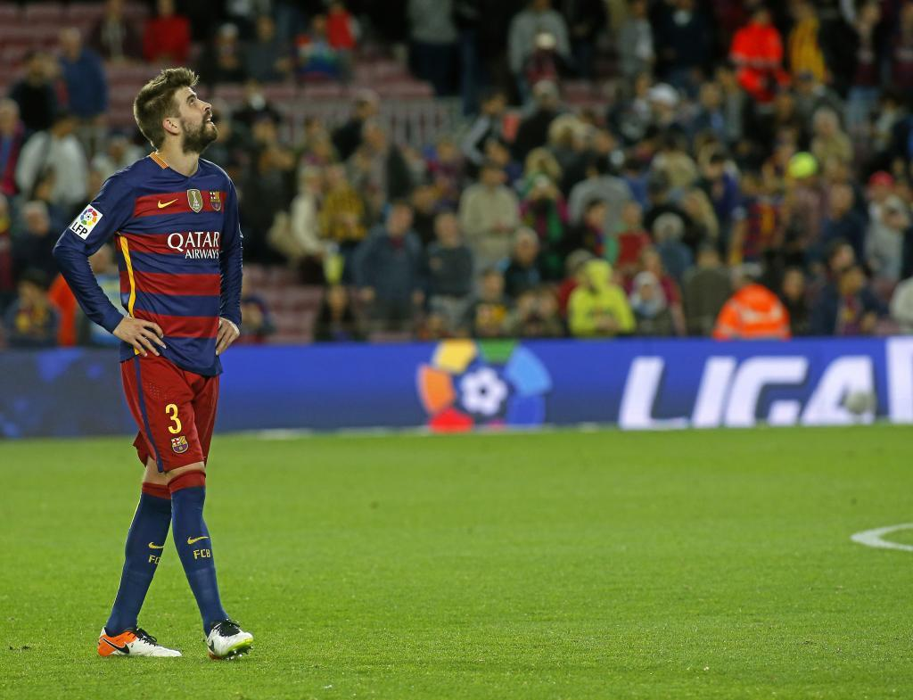 Pique looks to the sky in the match against Valencia.