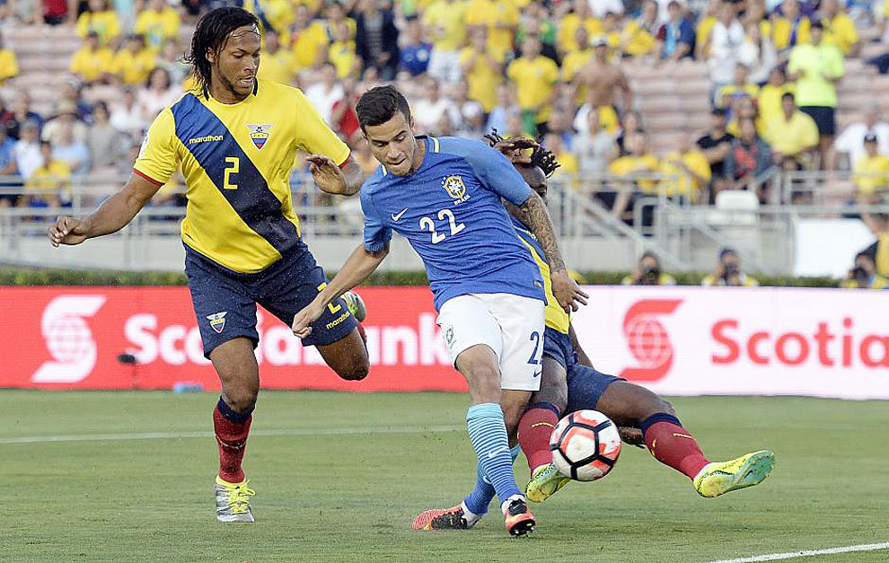 Coutinho, of Brazil, takes a shot on goal against Paredes and Mina, of...