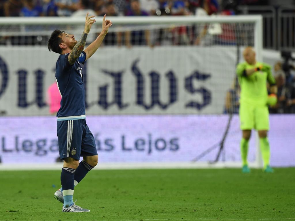Argentina's Lionel Messi celebrates after scoring against USA during...