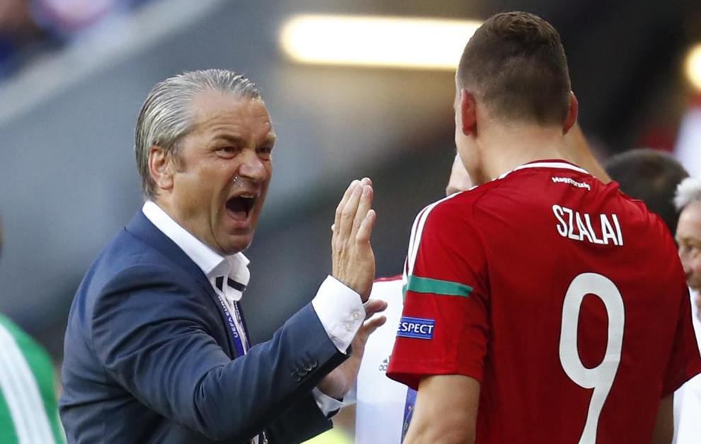 Hungary head coach Bernd Storck celebrates with Adam Szalai at the end...