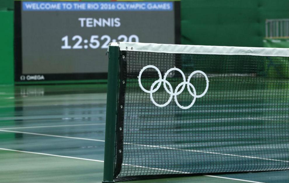 Pistas de tenis en el Centro Olímpico durante la jornada de lluvia.