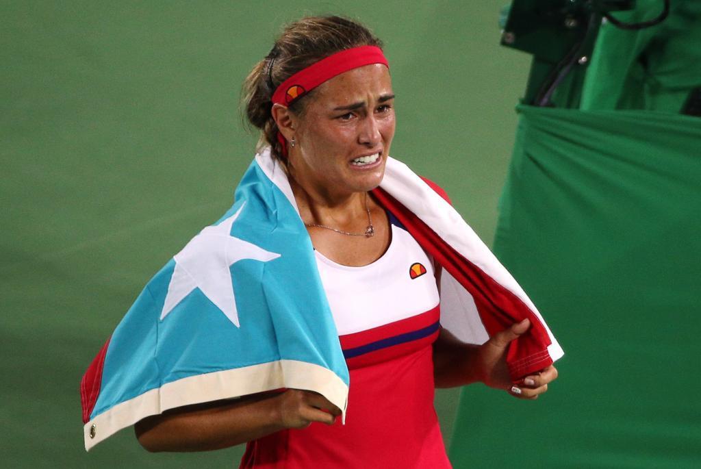 Mónica Puig llorando de alegría tras proclamarse campeona olímpica.