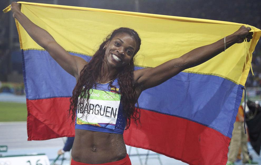 Ibarguen celebrating after winning gold in triple jump.
