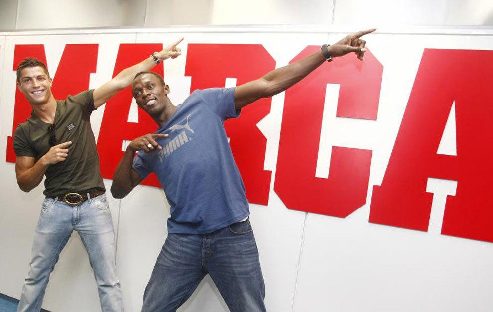 Cristiano Ronaldo y Usain Bolt, en una visita a MARCA