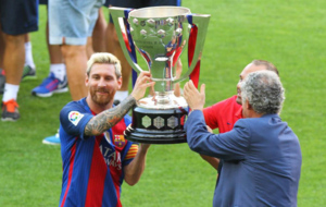 Messi and Iniesta parade the LaLiga trophy won in 2015/16