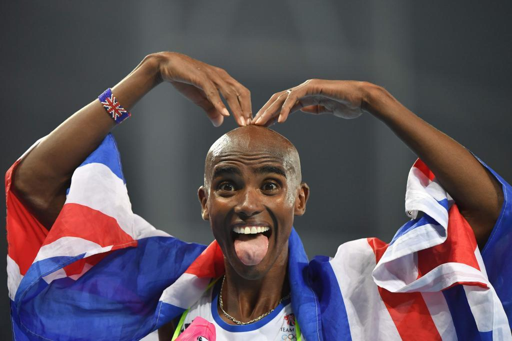 TOPSHOT - Britain's Mo Farah celebrates after he won the Men's 5000m...