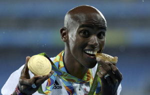 Mo Farah with his two gold medals.