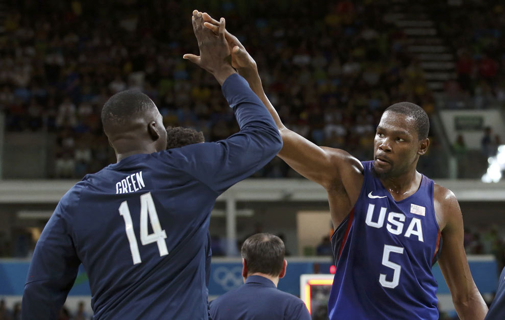 Kevin Durant celebrating with Draymond Green.