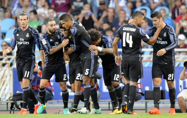 Real Madrid players celebrating after a goal against Real Sociedad.