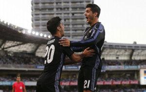 Asensio y Morata celebran un gol en la primera jornada de LaLiga