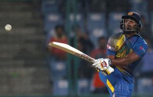 Sri Lanka's Thisara Perera plays a shot.