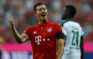 Robert Lewandowski celebrates after scoring a goal.