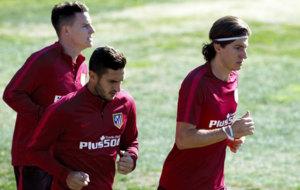 Filipe, Koke y Gameiro realizan carrera continua esta ma�ana.