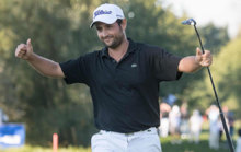 Alexander Levy celebrates winning the European Open title at Bad...