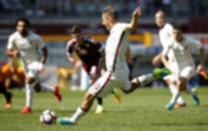 Totti scores a penalty against Torino.