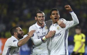 Raphael Varane reacts with Gareth Bale and Dani Carvajal.