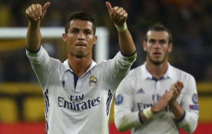 Cristiano Ronaldo react next to Gareth Bale.