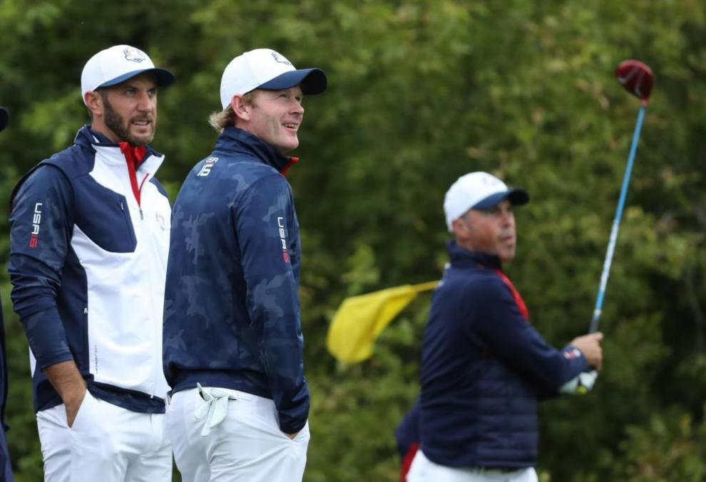 Dustin Johnson , Brandt Snedeker and Matt Kuchar (EE.UU), durante la...