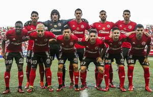 Once de los Xolos de Tijuana, Todos sus jugadores llevan botas rojas.