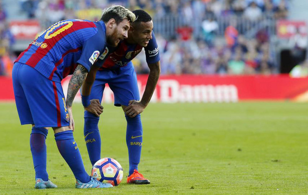 Messi and Neymar talk before taking a free kick against Deportivo.