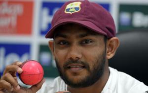 West Indies spinner Devendar Bishoo holds a pink ball.