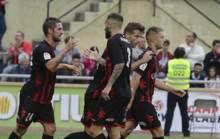 Los jugadores del Reus celebran el gol de M�yor al Lugo