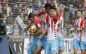 Los jugadores del Lugo celebrando el tanto de la victoria