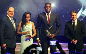 Usain Bolt y Almaz Ayana junto al Príncipe Albert II de Mónaco y...