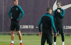 Messi y Luis Suárez durante un entrenamiento.