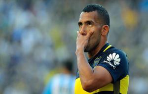 Carlos Tévez. en un partido con Boca.