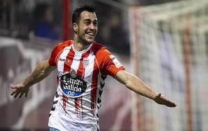 Joselu celebra uno de sus dos goles al Numancia en el Anxo Carro