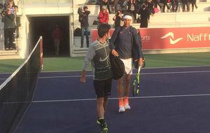 Nadal y Marc López entran en la pista