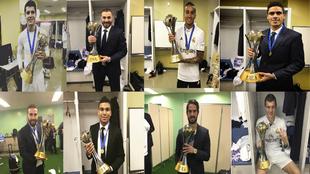 Los jugadores posan con la Copa que les acredita como campeones del...