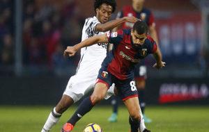 Cuadrado y Rincón, durante un Genoa-Juventus.