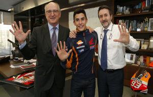 M�rquez, junto a Antonio Brufau y Josu Jon Imaz