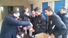 Los jugadores del Badajoz tomando chocolate con churros