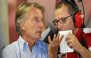 Montezemolo habla con Domenicali durante el GP de Italia de 2013.