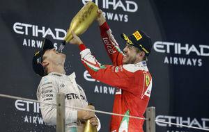 Rosberg y Vettel, en el podio de Abu Dabi