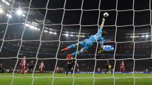 Atletico Madrid's midfielder Saul Niguez scores the 0-1 goal past...