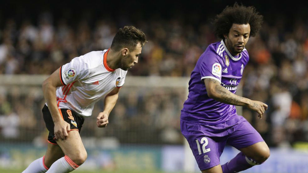 Marcelo y Munir en el partido entre Madrid y Valencia