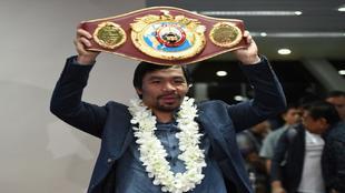 Manny Pacquiao con el cintur�n que pondr� en juego