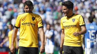 Pablo Fornals y Juankar, con gesto serio tras el partido.