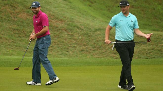 Sergio García y Jon Rahm, en un green.